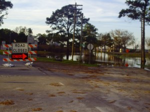 Barton and Megan Cutter drive through flooded waters.